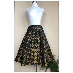 CAROLINA HERRERA FRONT PLEATED PRINTED SKIRT
